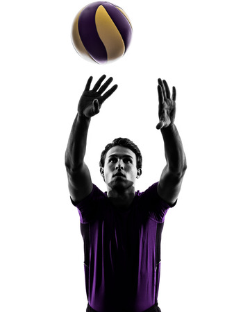 young volley ball player man in silhouette white background photo