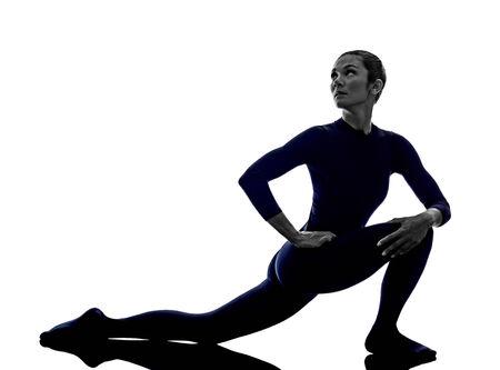 parsvakonasana: woman exercising Parivrrta Parsvakonasana Revolved Extended Side Angle pose yoga silhouette shadow white background