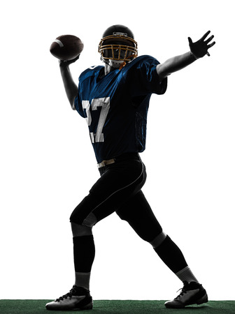 one  quarterback american throwing football player man in silhouette studio isolated on white background photo