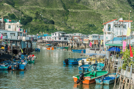 lantau: Tai O, Hong Kong, China- June 10, 2014: stilt houses and fishermen motorboats in Lantau island