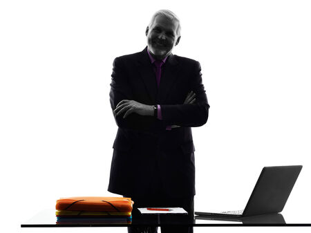 senior business man: One Caucasian Senior Business Man standing arms crossed smiling Silhouette White Background