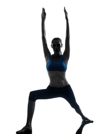 lunges: one  woman exercising yoga in silhouette studio isolated on white background Stock Photo