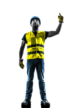 one construction worker signaling looking up hoist silhouette isolated in white background photo