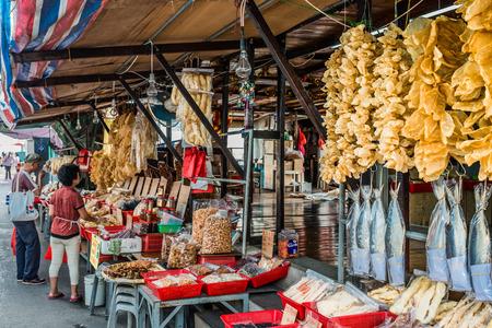 lantau: Tai O, Hong Kong, China- June 10, 2014: people shopping at the seafood market in Lantau island
