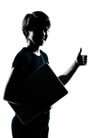teen silhouette: one  young teenager silhouette boy girl holding carrying laptop computer thumb up portrait in studio cut out isolated on white background Stock Photo