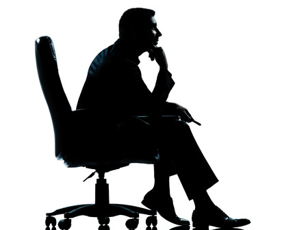 to beckon: one  business man sitting in armchair silhouette Full length in studio isolated on white background