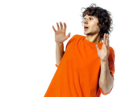 one young man  gesturing surprised fear afraid portrait in studio white background photo