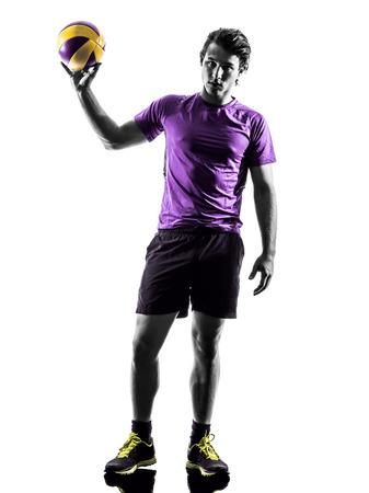 ballon volley: jeune joueur de volley-ball homme en silhouette fond blanc