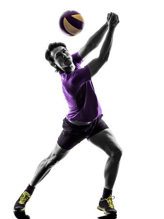 pelota de voleibol: jugador joven hombre de voleibol en la silueta de fondo blanco Foto de archivo