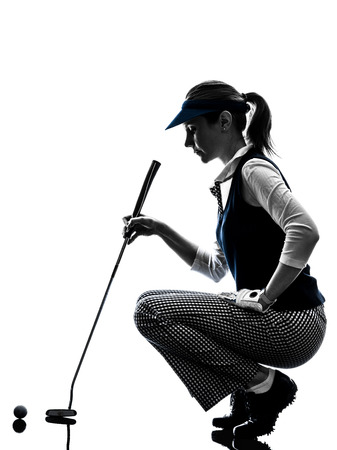 woman golfer golfing silhouette in white background photo