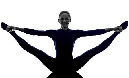 asanas: woman exercising stretching splits yoga silhouette shadow white background