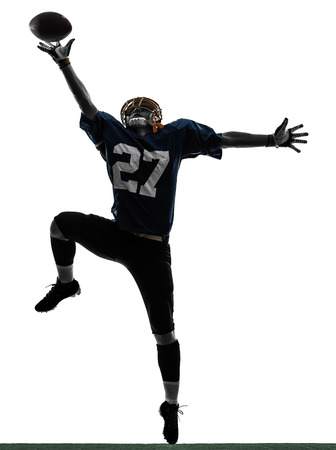 one  american football player man catching receiving in silhouette studio isolated on white background photo