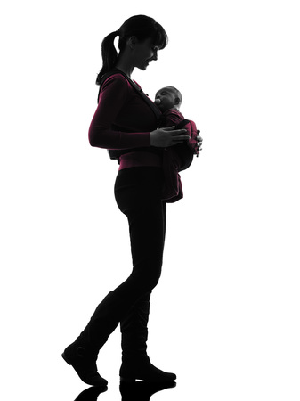 baby carrier: one  woman mother walking baby silhouette on white background Stock Photo