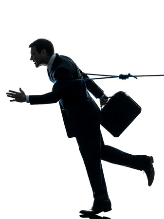 one  business man catched by lasso rope in silhouette studio isolated on white background photo