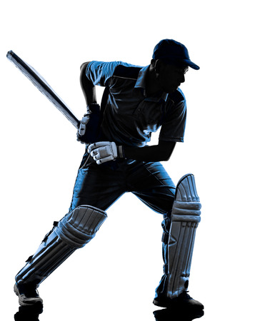 白い背景にシルエットの影でクリケット プレーヤー打者 写真素材