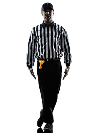 tripping: american football referee gestures tripping in silhouette on white background