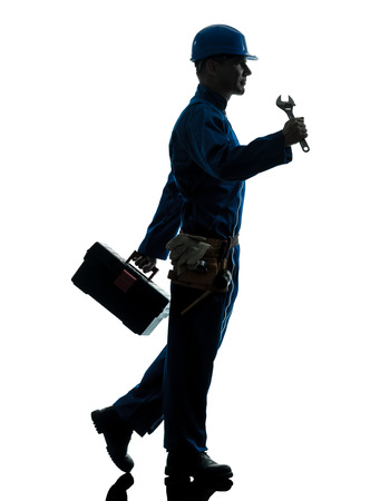 one  repairman worker silhouette in studio on white background photo