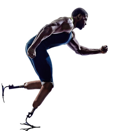 disabled sports: one muscular handicapped man runners sprinters with legs prosthesis in silhouette on white background