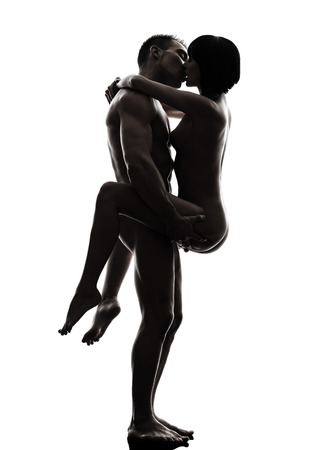sex activity: one  couple man woman sexual kamasutra posture love activity in silhouette studio on white background Stock Photo