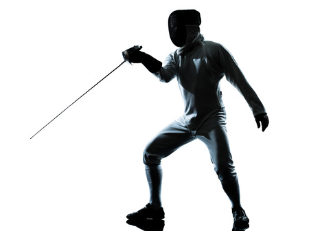 fencing sword: one man fencing silhouette in studio isolated on white background