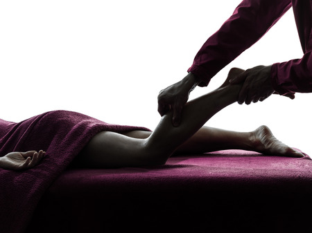 man woman legs massage therapy in silhouette studio on white background