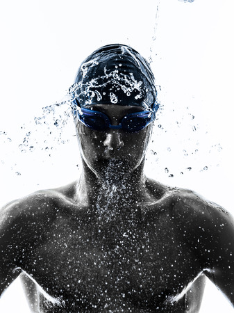 1: one young man swimmer swimming in silhouette on white background