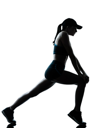side profile: one  woman runner jogger stretching warm up in silhouette studio isolated on white background Stock Photo