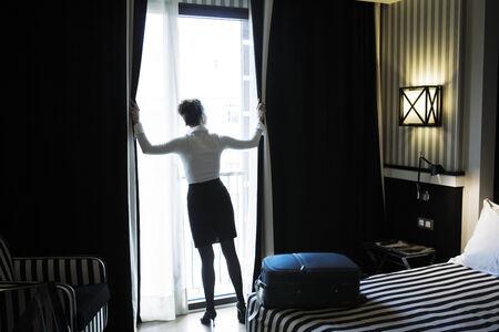 hotel bedroom: beautiful  woman arriving in a hotel bedroom