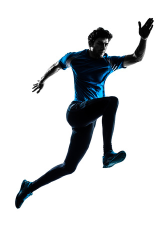 one  man running sprinting jogging in silhouette studio isolated on white