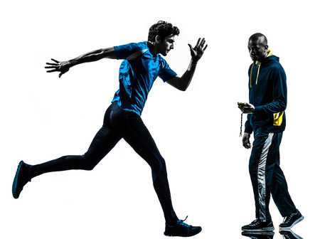 stopwatch: one  man running sprinting with coach stopwatch in silhouette studio isolated on white  Stock Photo