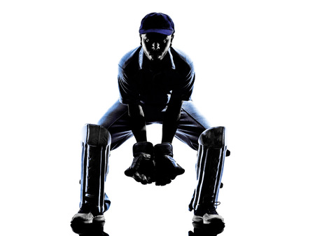 cricket sport: Cricket player receiver in silhouette shadow on white