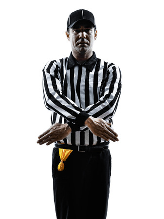 refused: american football referee gestures penalty refused in silhouette on white