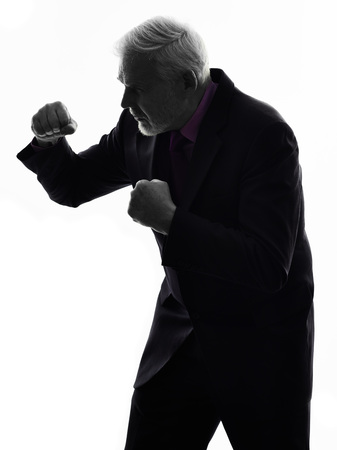 senior business man: One Caucasian Senior Business Man punching the air Silhouette White  Stock Photo