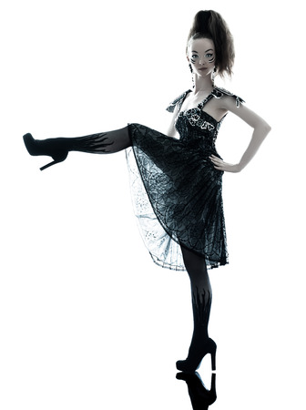 one young beautiful woman fashion model in on aura tout vu silk black fantasy haute couture summer dress in studio white  Banque d'images