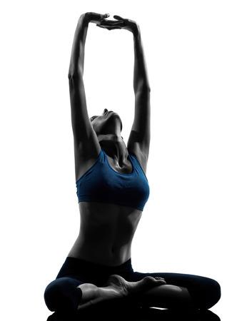 sukhasana: One Woman Exercising Yoga Sukhasana Easy Pose In Silhouette Studio Isolated On White