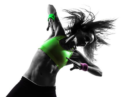 zumba: one  woman exercising fitness zumba dancing in silhouette on white  Stock Photo