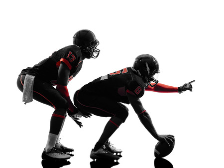player: two american football players on scrimmage in silhouette shadow white background
