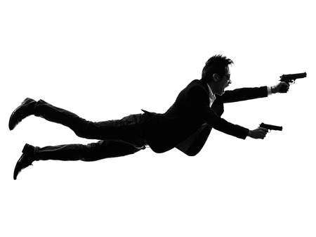 gangster background: one asian gunman killer jumping shooting in silhouette isolated white background