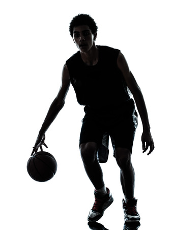 sport silhouette: one young man basketball player silhouette in studio isolated on white background Stock Photo