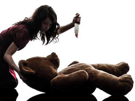 killings: one  strange young woman killing her teddy bear in silhouette white background
