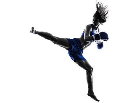 one woman boxer boxing kickboxing in silhouette isolated on white background Standard-Bild