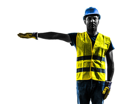 one construction worker signaling with safety vest silhouette isolated in white background photo
