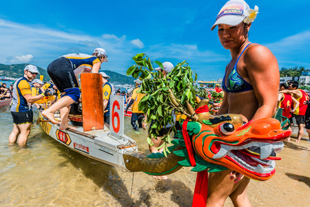 stanley: Hong Kong, China- June 2 , 2014: People racing the Dragon boats festival race in Stanley beach