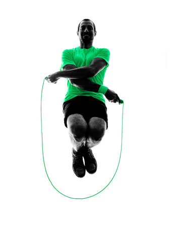 one man exercising jumping rope  fitness  in silhouette isolated on white background photo