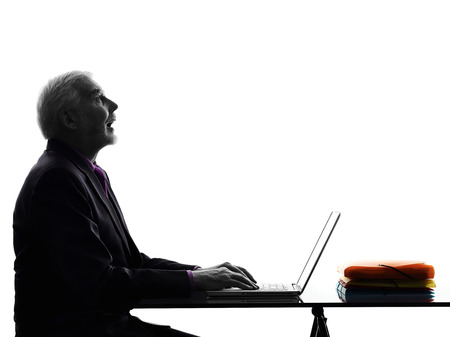 One Caucasian Senior Business Man computing laptop looking up mouth open Silhouette White Background photo