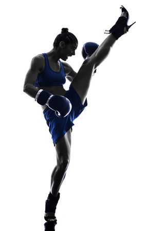 martial art: one woman boxer boxing kickboxing in silhouette isolated on white background Stock Photo
