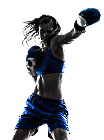one woman boxer boxing kickboxing in silhouette isolated on white background Foto de archivo