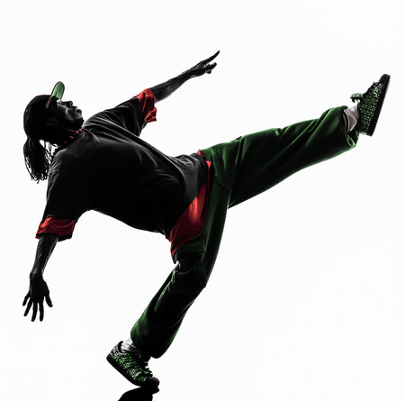 danza africana: uno hip hop bailarín de la rotura acrobática breakdance joven silueta fondo blanco Foto de archivo