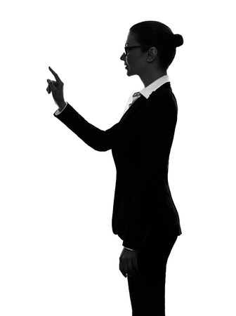 copy sapce: one  business woman touching copy sapce in silhouette on white background