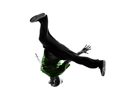 dance studio: one  young acrobatic break dancer breakdancing man in silhouette white background